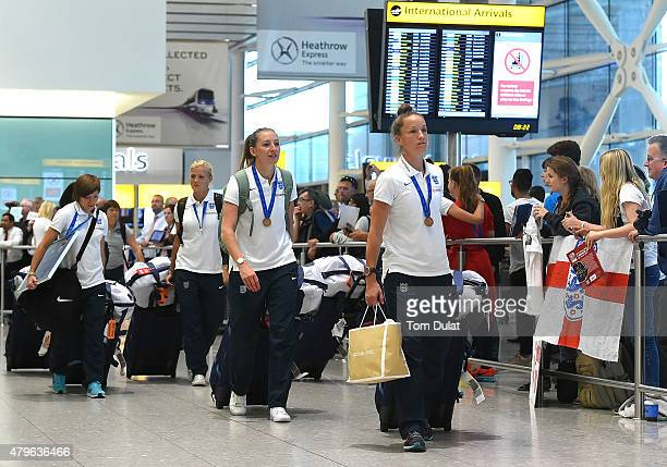 England Women's football team arrives from the World Cup at Heathrow Airport on July 6 2015 in London England