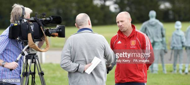 England Women's Head Coach Danny Kerry speaks to the local TV during the Women's Champions Trophy Media Day at Beeston HC Nottingham