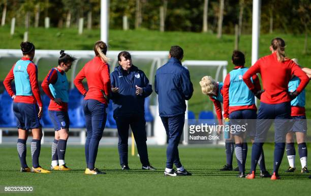 England Women's interim head coach Mo Marley speaks to her players during a training session at St Georges Park on October 17 2017 in BurtonuponTrent...