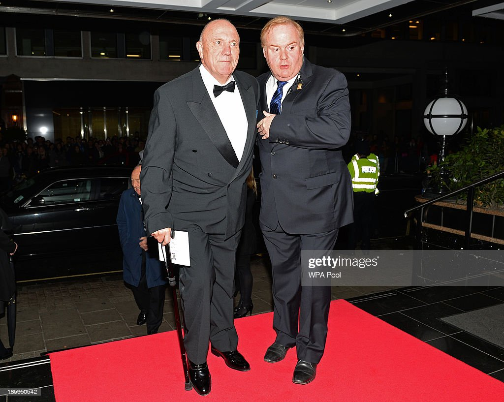 England World Cup team mamber George Cohen (L) arrives to attend The Football Association's 150th Anniversary Gala Dinner at the Grand Connaught Rooms on October 26, 2013 in London, England. The Duke of Cambridge is president of the Football Association, which was founded 150 years ago on October 26, 1863. The event marks the day when a group of men representing a dozen London and suburban clubs met at the Freemason's Tavern in London, to draw up the rules of a sport that went on to become the most popular in the world.