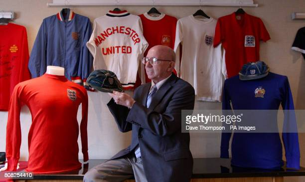 England World Cup winner Nobby Stiles holds his 1966 World Cup tournament cap during a photocall at the Premier Inn Hotel in Old Trafford Manchester