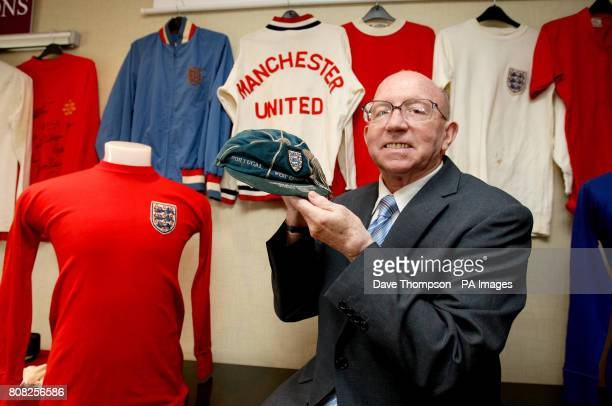 England World Cup winner Nobby Stiles holds his 1966 World Cup tournament cap alongside the Alan Ball's 1966 England shirt right during a photocall...
