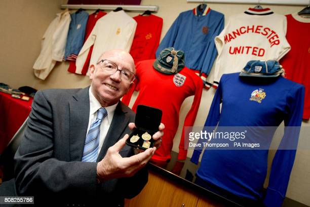 England World Cup winner Nobby Stiles holds his 1966 World Cup winners medal during a photocall at the Premier Inn Hotel in Old Trafford Manchester