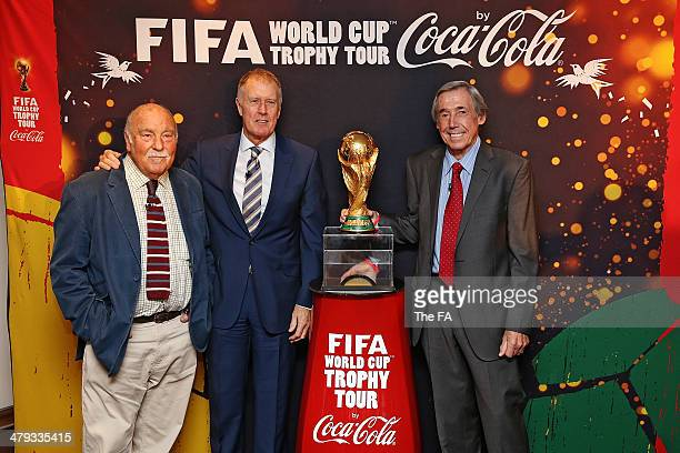 England World Cup winners Jimmy Greaves Sir Geoff Hurst and Gordon Banks unveil the FIFA World Cup Trophy at Wembley Stadium as part of celebrations...