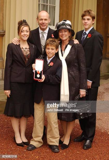 England World Cup winning coach Sir Clive Woodward with his wife Jayne daughter Jess aged 18 sons Joe 16 and Freddie ten after receiving his...