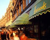 England,London,Knightsbridge,crowds passing by Harrods,long exposure