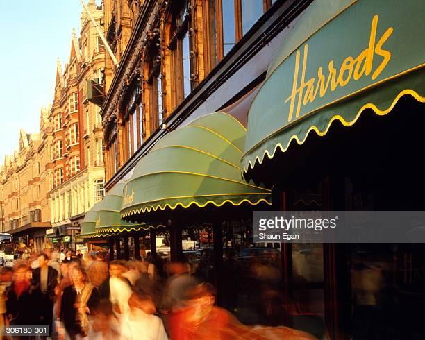 England,London,Knightsbridge,crowds passing by Harrods,long exposure