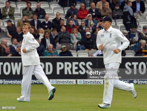 England's 12th man Billy Root and brother Joe Root are seen in the field during the first test at Lord's Cricket Ground London