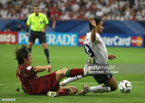 England's Aaron Lennon is brought down in the area by Portugal's Jorge Nuno Valente