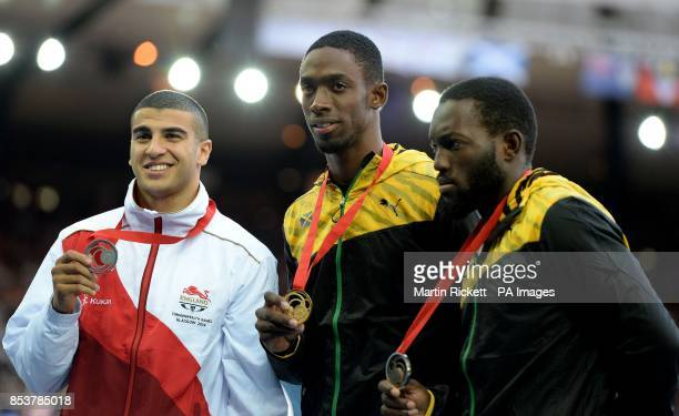England's Adam Gemili celebrates with his silver medal alongside gold medal winner Jamaica's Kemar BaileyCole and bronze medal winner Jamaica's...