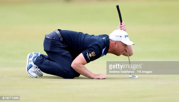 England's Adam Hodkinson lines up a putt on the 1st during day one of The Open Championship 2017 at Royal Birkdale Golf Club Southport
