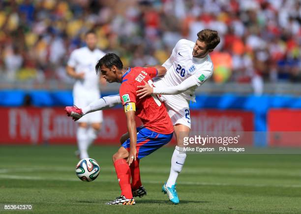 England's Adam Lallana and Costa Rica's Bryan Ruiz battle for the ball during the FIFA World Cup Group D match at the Estadio Mineirao Belo Horizonte...