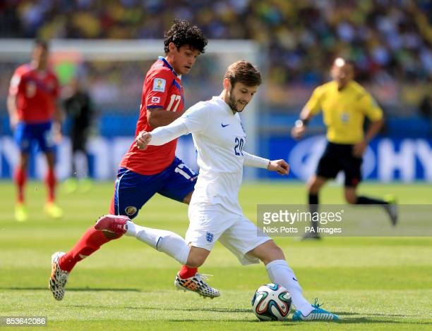 England's Adam Lallana and Costa Rica's Yeltsin Tejeda battle for the ball during the FIFA World Cup Group D match at the Estadio Mineirao Belo...
