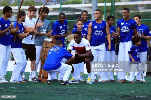 England's Adam Lallana and Danny Welbeck during a visit to the Complexo Esportivo da Rocinha Rio de Janeiro Brazil