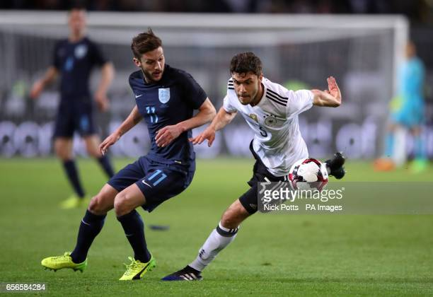 England's Adam Lallana and Germany's Jonas Hector battle for the ball during the International Friendly match at Signal Iduna Park Dortmund