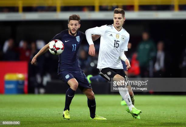 England's Adam Lallana and Germany's Julian Weigl battle for the ball during the International Friendly match at Signal Iduna Park Dortmund