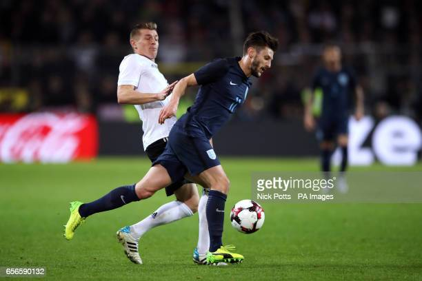 England's Adam Lallana and Germany's Toni Kroos battle for the ball during the International Friendly match at Signal Iduna Park Dortmund