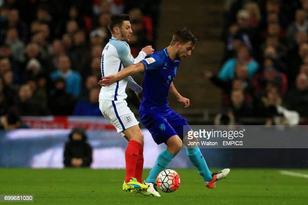 England's Adam Lallana and The Netherlands' Joel Veltman battle for the ball during the International Friendly match at Wembley Stadium London