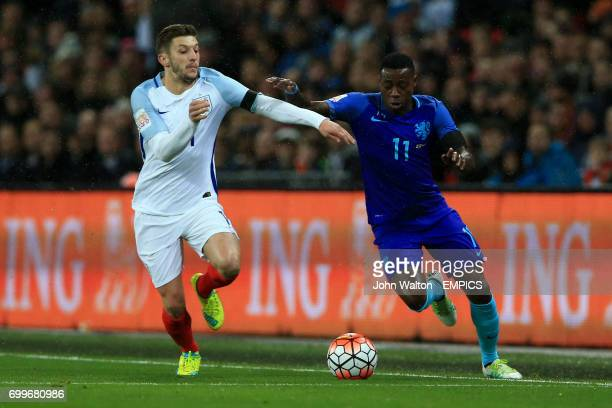 England's Adam Lallana and The Netherlands' Quincy Promes battle for the ball during the International Friendly match at Wembley Stadium London