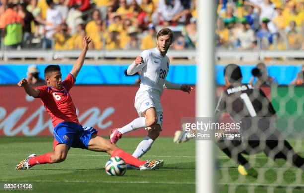 England's Adam Lallana has a shot on target past Costa Rica's Oscar Duarte during the FIFA World Cup Group D match at the Estadio Mineirao Belo...