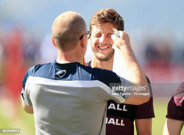 England's Adam Lallana is sprayed with water during the training session at Urca Military Training Ground Rio de Janeiro Brazil