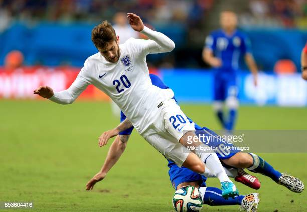 England's Adam Lallana is tackled by Italy's Daniele De Rossi during the FIFA World Cup Group D match at the Arena da Amazonia Manaus Brazil