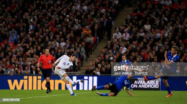 England's Adam Lallana shoots as Estonia's Sergei Zenjov attempts to block