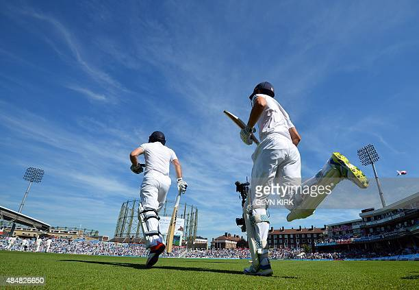 England's Adam Lyth and England's captain Alastair Cook return to bat after Australia enforce the followon on the third day of the fifth Ashes...