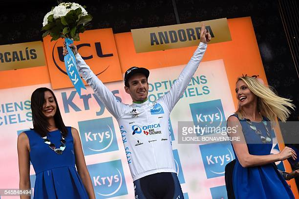 England's Adam Yates celebrates his white jersey of best young on the podium at the end of the 1845 km ninth stage of the 103rd edition of the Tour...