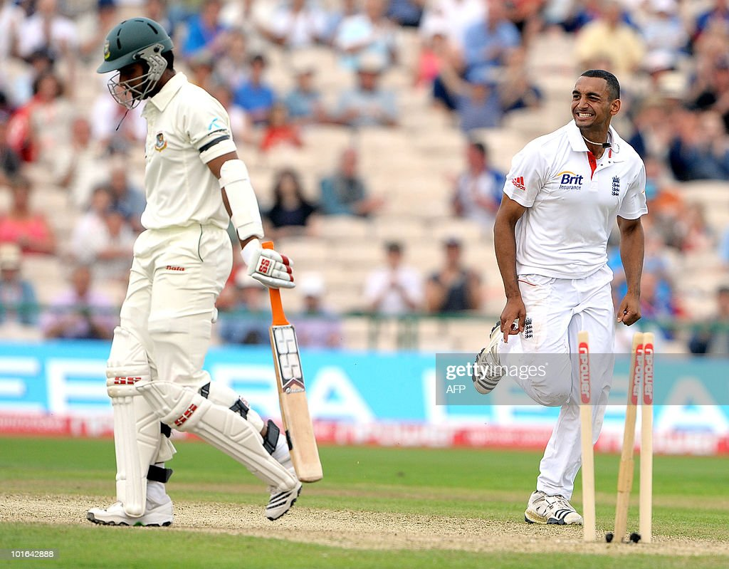 England's Ajmal Shahzad (R) celebrates after bowling Mahmudullah of Bangladesh (L) during the second day of the second Test match at Old Trafford in Manchester, north-west England on June 5 2010. Ian Bell scored his third century against Bangladesh but Tamim Iqbal led a spirited fightback as the Tigers refused to yield on the second day of the second Test here at Old Trafford.
