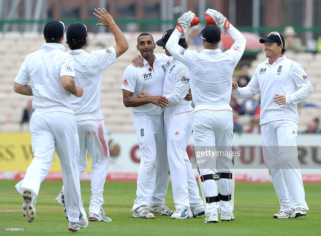 England's Ajmal Shahzad (C) celebrates after taking the wicket of Shakib Al Hasan of Bangladesh during the third day of the second Test match between England and Bangladesh at Old Trafford in Manchester, northwest England, on June 6, 2010.