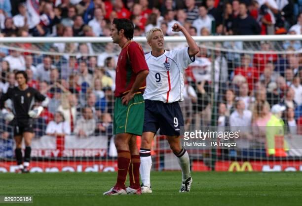 England's Alan smith celebrates scoring the opening goal next to Portugal's Luis Figo during the International friendly match at Villa Park...