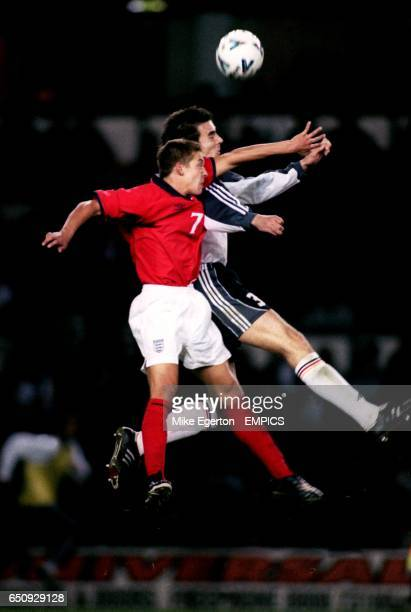 England's Alan Smith jumps for a header with Germany's Christoph Metzelder