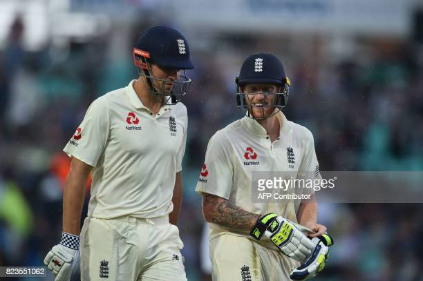 England's Alastair Cook and England's Ben Stokes walk off the pitch as rain delays play on the first day of the third Test match between England and...