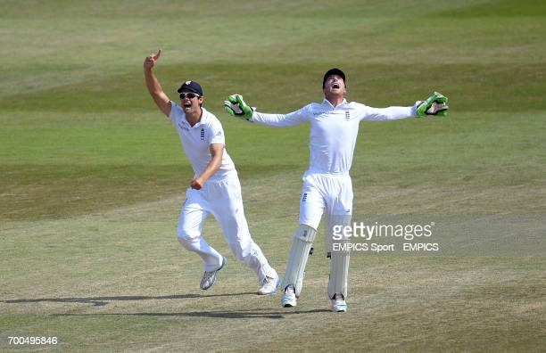 England's Alastair Cook and Jos Buttler celebrate after James Anderson takes the wicket of India's Rohit Sharma during day five of the Third Investec...
