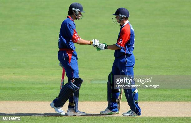 England's Alastair Cook and Phil Mustard congratulate each other during the Fourth One Day International match at McLean Park Napier New Zealand