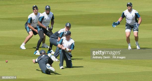 England's Alastair Cook Chris Jordan Gary Ballance Ian Bell and Matt Prior lookon as Sam Robson dives for a catch during a nets session at Lords...