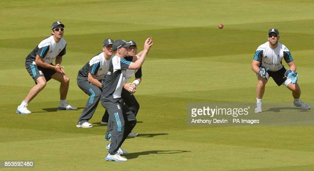 England's Alastair Cook Gary Ballance Ian Bell and Matt Prior lookon as Sam Robson catches during a nets session at Lords Cricket Ground London