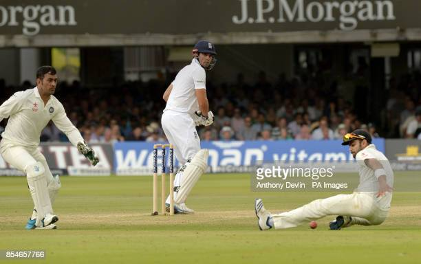 England's Alastair Cook hits a shot past India's Virat Kohli during day four of the second test at Lord's Cricket Ground London