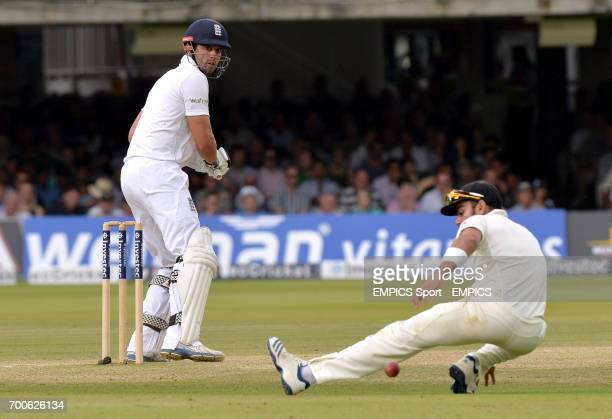 England's Alastair Cook hits a shot past India's Virat Kohli