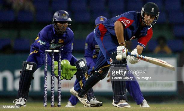 England's Alastair Cook hits past Sri Lankan wicketkeeper Kumar Sangakkara during the Fourth One Day International at R Premadasa Stadium Colombo Sri...