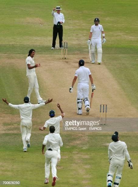 England's Alastair Cook is caught behind by India's MS Dhoni off the bowling of Ishant Sharma for 22 runs during day four of the second test at...