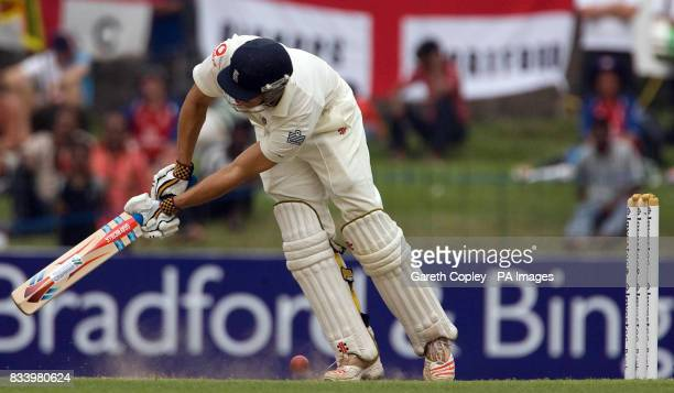England''s Alastair Cook is trapped LBW by Lasith Malinga during the Second Test at the Sinhalese Sports Club Ground Colombo Sri Lanka