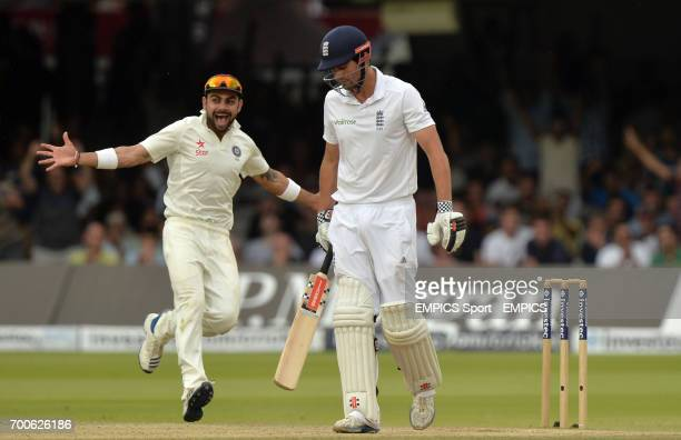 England's Alastair Cook leaves the field after being caught behind by India's MS Dhoni off the bowling of Ishant Sharma for 22 runs during day four...