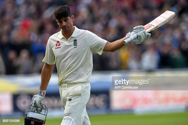 England's Alastair Cook leaves the field after losing his wicket for 243 during play on day 2 of the first Test cricket match between England and the...