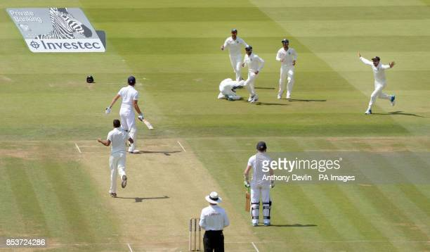 England's Alastair Cook looks back as he is caught behind by India's MS Dhoni off the bowling of Bhuvneshwar Kumar for 10 during day two of the...