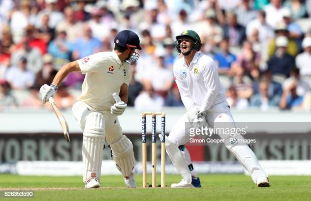 England's Alastair Cook looks back to see South Africa's Quinton Du Kock catch him out off the bowling of Keshav Maharaj during the Fourth Investec...