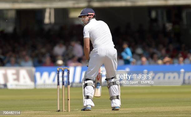 England's Alastair Cook looks on as he is caught behind by India's MS Dhoni off the bowling of Bhuvneshwar Kumar for 10 during day two of the second...