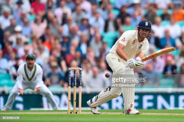 England's Alastair Cook plays a shot on the first day of the third Test match between England and South Africa at The Oval cricket ground in London...