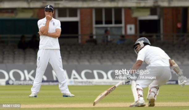 England's Alastair Cook reacts as Sri Lanka's Kumar Sangakkara runs between the wickets during day five of the Investec Test match at Lord's Cricket...
